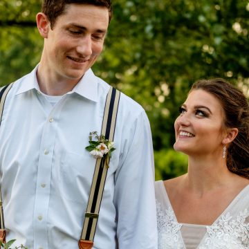 Bride and Groom walking through Ault Park during wedding day