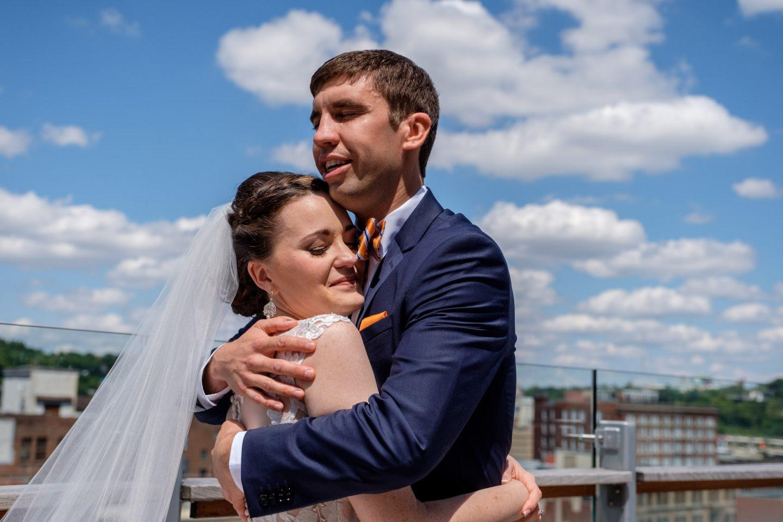 Bride and groom hug during first look before wedding ceremony at 21C Hotel in Cincinnati, Ohio.