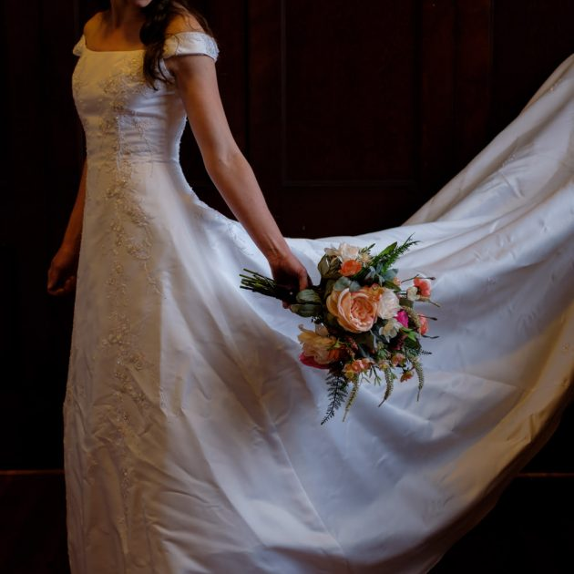 Bride holding flower bouquet at church in Cincinnati.